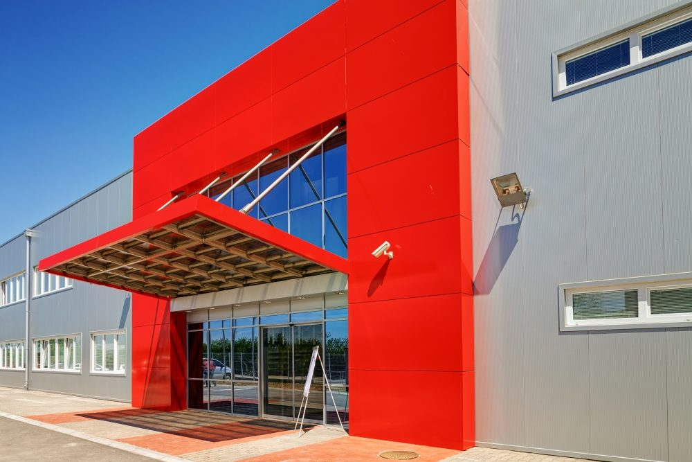 Facade on large industrial building made of aluminum panels